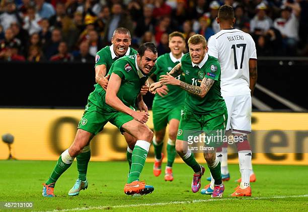John O'Shea of the Republic of Ireland celebrates scoring the stoppage time equaliserduring the EURO 2016 Qualifier between Germany and Republic of...