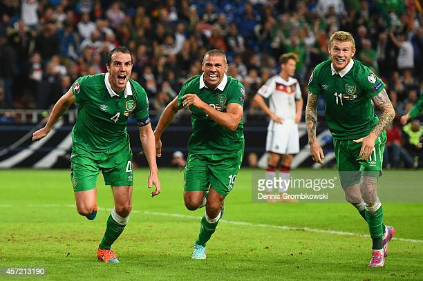 John O'Shea of the Republic of Ireland celebrates scoring the stoppage time equaliser with James McClean and Jon Walters of the Republic of Ireland...