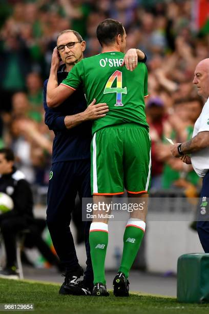 John O'Shea of the Republic of Ireland hugs Martin O'Neill Manager of The Republic of Ireland as he is substituted off for the final time during the...