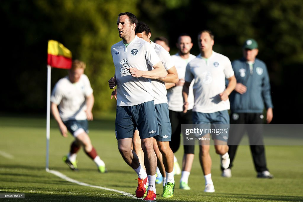 John O'Shea of the Republic of Ireland leads other squad members as he runs during an Ireland training session at Watford FC Training Ground on May 26, 2013 near St Albans, London Colney, England.