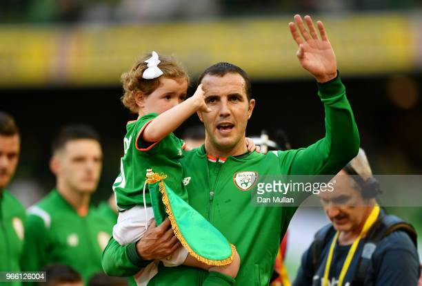 John O'Shea of the Republic of Ireland waves goodbye to the fans ahead of his final game during the International Friendly match between the Republic...