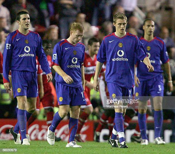John O'Shea, Paul Scholes and Darren Fletcher of Manchester United look disappointed while walking off at half-time during the Barclays Premiership...