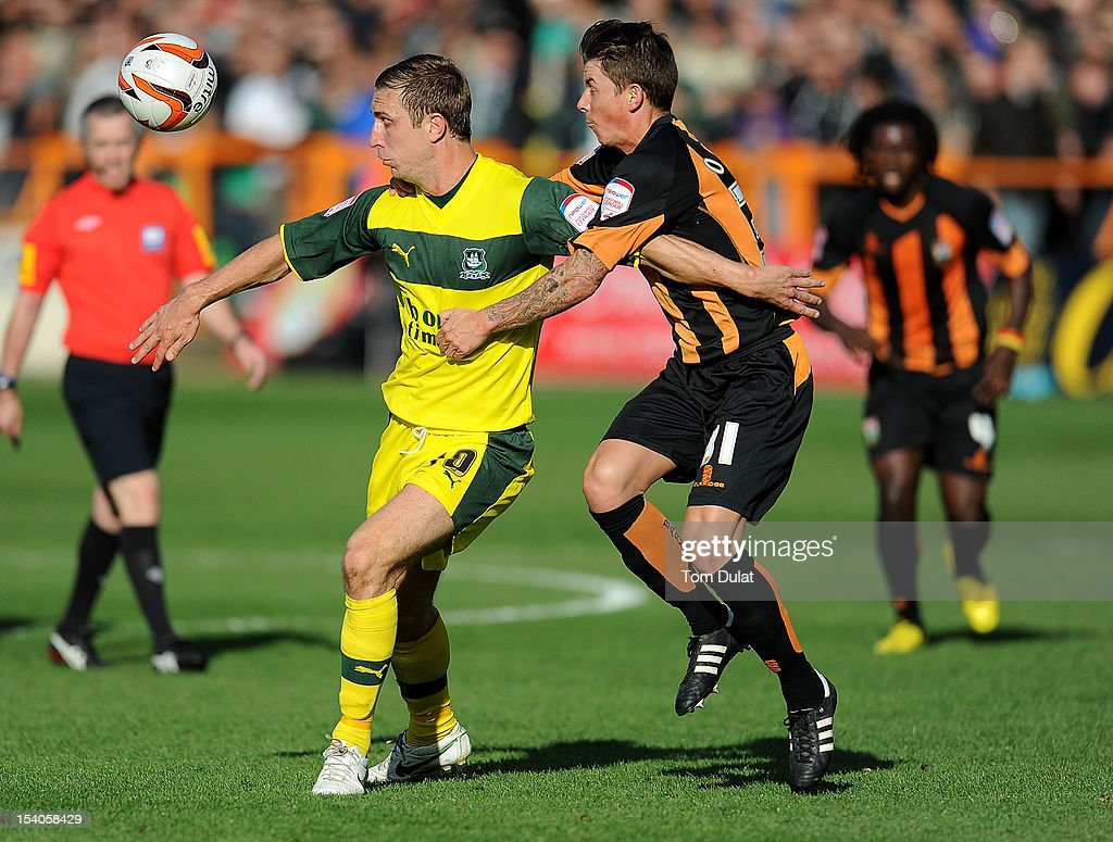 John Oster of Barnet and Rhys Griffiths of Plymouth Argyle in action during the npower League Two match between Barnet and Plymouth Argyle at Underhill Stadium on October 13, 2012 in Barnet, England.