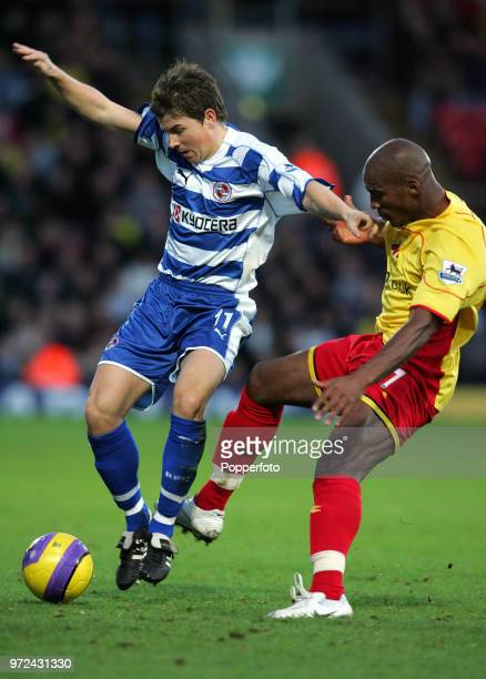 John Oster of Reading and Damien Francis of Watford in action during the Barclays Premiership match between Watford and Reading at Vicarage Road in...