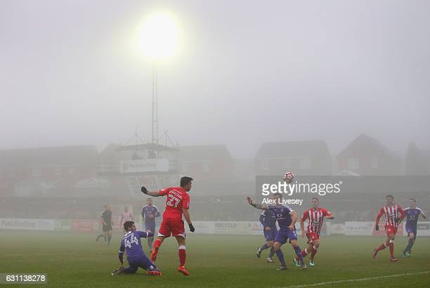 John O'Sullivan of Accrington Stanley heads the ball across the Luton Town penalty area as fog descends during the Emirates FA Cup Third Round match...