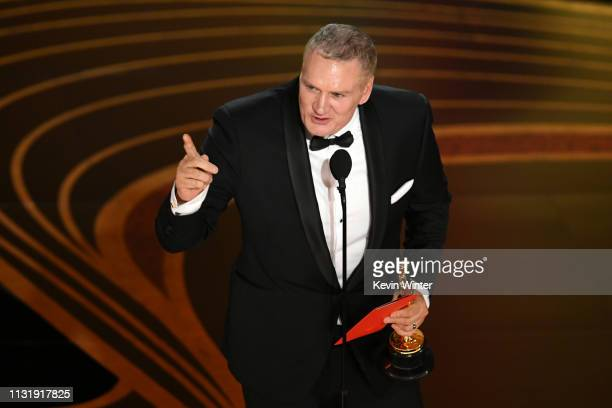 John Ottman accepts the Film Editing award for 'Bohemian Rhapsody' onstage during the 91st Annual Academy Awards at Dolby Theatre on February 24 2019...