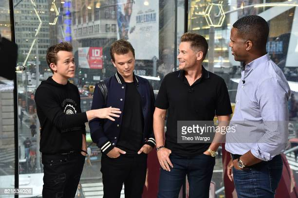 John Owen Lowe Matthew Lowe Rob Lowe and AJ Calloway on set of 'Extra' at HM in Times Square on July 24 2017 in New York City