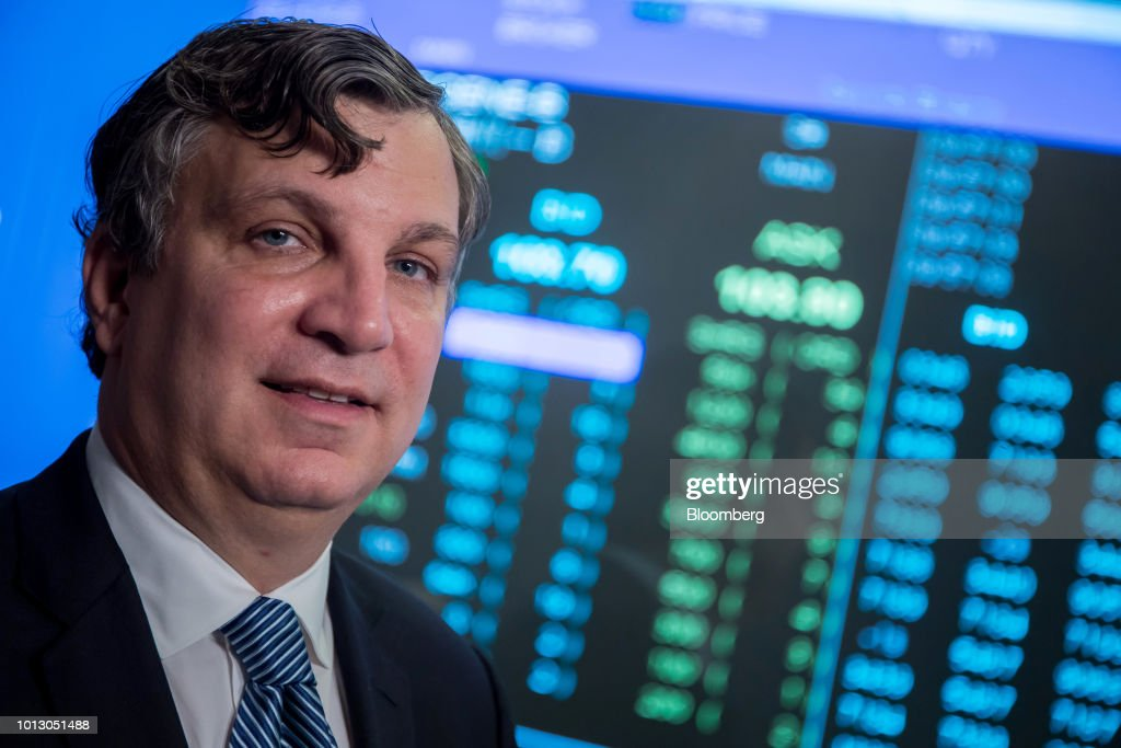 John Oyler, founder and chief executive officer of BeiGene Ltd., stands for a photograph following the company's listing ceremony at the Hong Kong Stock Exchange in Hong Kong, China, on Wednesday, Aug. 8, 2018. Chinese cancer drug developer BeiGene fell on its debut in Hong Kong even as its chief executive officer laid out ambitions to become a homegrown champion as well as a global company. Photographer: Paul Yeung/Bloomberg via Getty Images