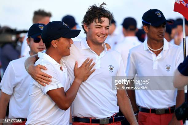 John Pak and Tyler Strafaci of Team USA celebrate during Sunday singles matches on Day Two of The Walker Cup at Seminole Golf Club on May 09, 2021 in...