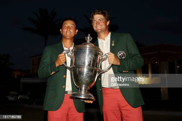 John Pak and Tyler Strafaci of Team USA pose with the trophy after defeating Team Great Britain and Ireland 14-12 during Sunday singles matches on...