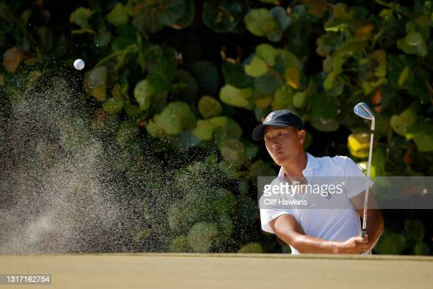John Pak of Team USA plays his shot from the bunker on the 13th hole during Sunday singles matches on Day Two of The Walker Cup at Seminole Golf Club...