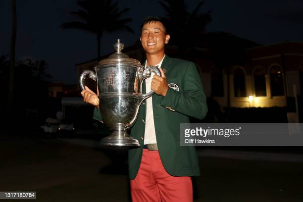 John Pak of Team USA poses with the trophy after Team USA defeated Team Great Britain and Ireland 14-12 on Day Two of The Walker Cup at Seminole Golf...