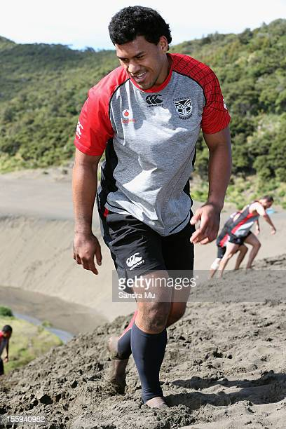John Palavi of the Warriors trains on the sand dunes during the New Zealand Warriors NRL training session at Bethells Beach on November 10 2012 in...