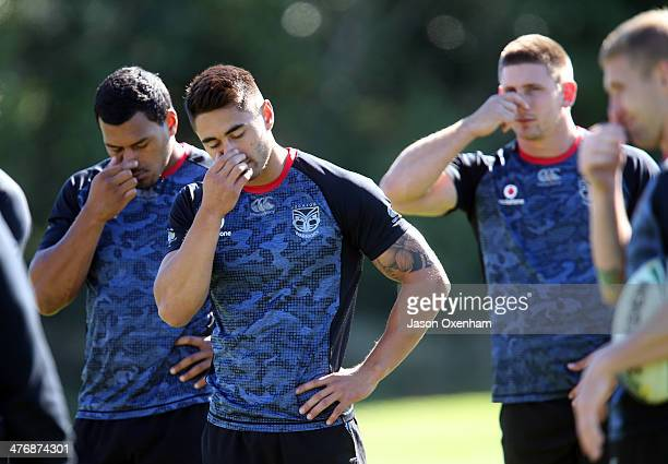 John Palavi Shaun Johnson and Jacob Lillyman of the Warriors perform breathing exercises before a New Zealand Warriors NRL training session at Mt...