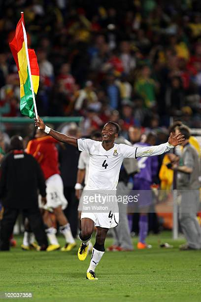 John Pantsil of Ghana celebrates victory with the national flag after the 2010 FIFA World Cup South Africa Group D match between Serbia and Ghana at...