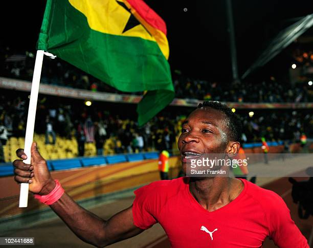 John Pantsil of Ghana flies the national flag as he celebrates victory following the 2010 FIFA World Cup South Africa Round of Sixteen match between...