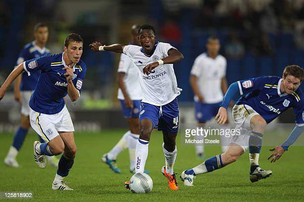 John Pantsil of Leicester City cuts between Filip Kiss and Darcy Blake of Cardiff City during the Carling Cup third round match between Cardiff City...