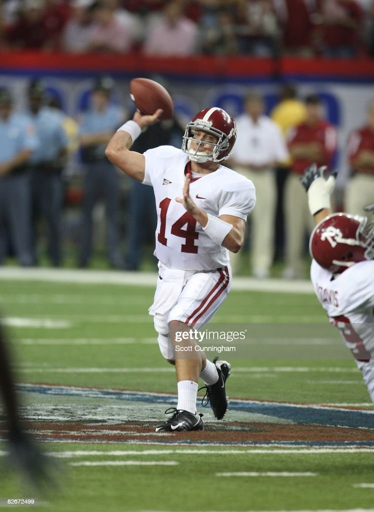 John Parker Wilson #14 of the Alabama Crimson Tide passes against the Clemson Tigers at the Georgia Dome on August 30, 2008 in Atlanta, Georgia.
