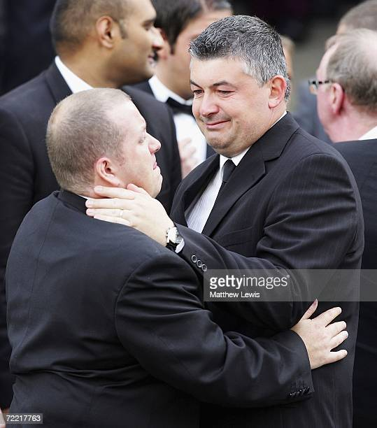 John Parrot consoles a friend after the funeral of Paul Hunter at Leeds Parish Church on October 19, 2006 in Leeds, England. The three-time Masters...