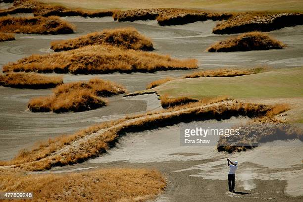 John Parry of England hits his second shot on the 14th hole during the second round of the 115th US Open Championship at Chambers Bay on June 19 2015...
