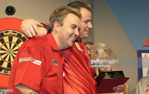 John Part with the PDC World Championship trophy after defeating Phil Taylor in the PDC Ladbrokescom World Darts Championships at the Circus Tavern...