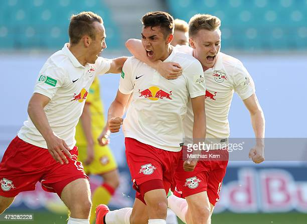 John Patrick Strauss of Leipzig jubilates with team mates after scoring the third goal during the U19 A Juniors Bundesliga semi final match between...