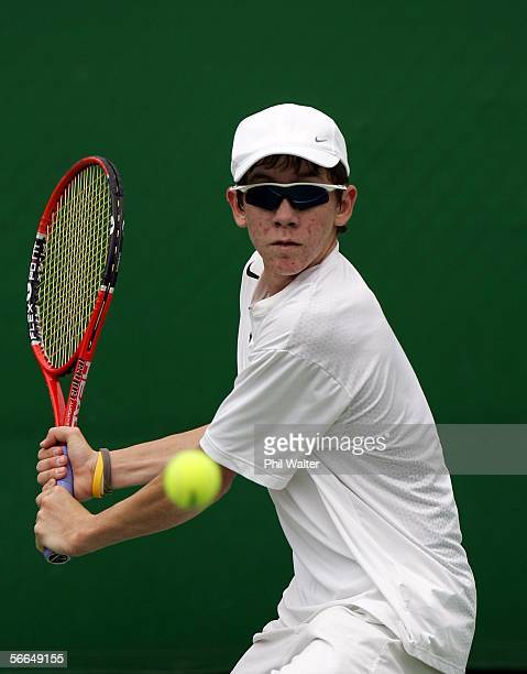 John PatrickSmith of Australia plays a backhand in his match against Luka Belic of Croatia during the Australian Open Junior Championship at...