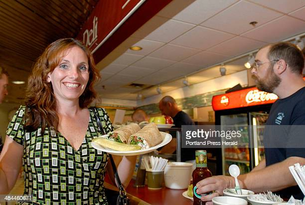 Monday July 9 2007 Teresa Bradford from Binghamton NY purchases a turkey club rollup at City Deli in the food court at One City Center in Portland...