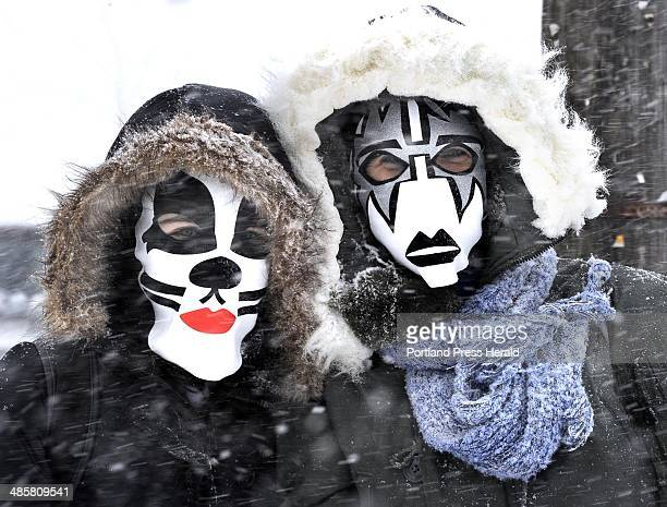 John Patriquin /Staff Photographer Wed 1/12/11 15 year old Amelia Trafton and her mother Sara Trafton wearing colorful and scary ski masks walk along...