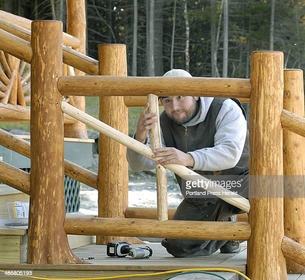John Patriquin/Staff Photographer FridaySept25 2009 Carpenter Cedric Simpson custom fits spruce spindles on the exterior railings as construction of...