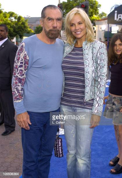 John Paul DeJoria and wife Eloise during I ROBOT World Premiere Blue Carpet at Mann Village in Westwood California United States