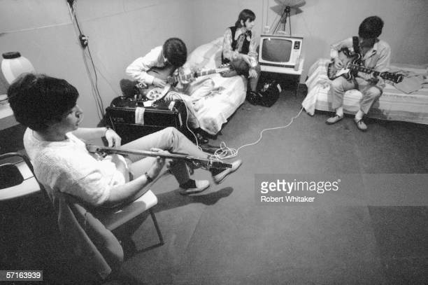 John Paul George and Ringo tune up in a hotel room during the Beatles' Asian tour 1966