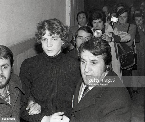 John Paul Getty III is escorted by plainclothes police as he arrives at Rome's Police Headquarters Eldest of the four children of John Paul Getty Jr...