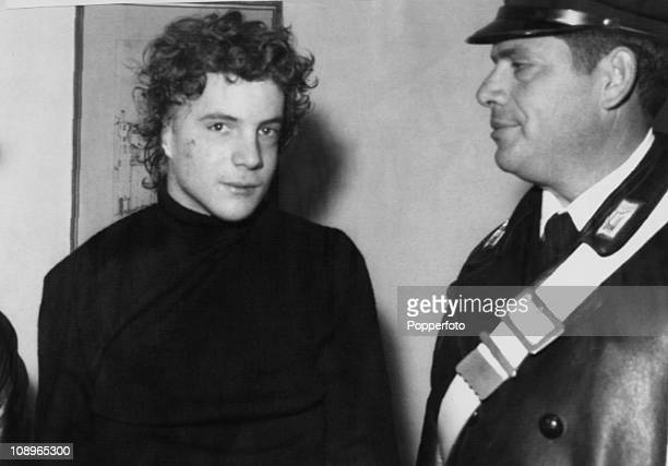John Paul Getty III the grandson of American oil tycoon Jean Paul Getty with a police officer after his kidnapping Italy December 1973 Getty's ear...