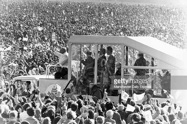John Paul II in his 'popemobile' waves to the huge crowds who turned out to greet him during his visit to Ireland on September 29 1979