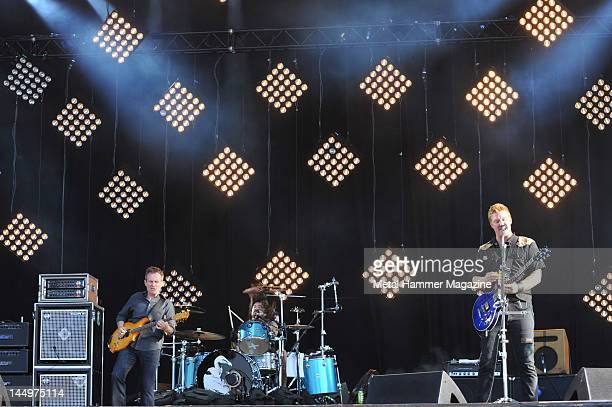 John Paul Jones Dave Grohl and Josh Homme of hard rock supergroup Them Crooked Vultures performing live on stage at Download Festival on June 11 2010...
