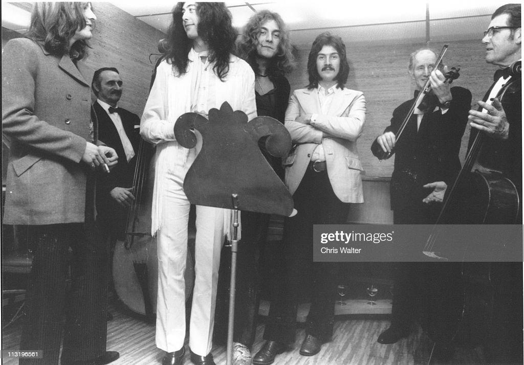 John Paul Jones, Jimmy Page, Robert Plant and John Bonham of Led Zeppelin, with guest musicians