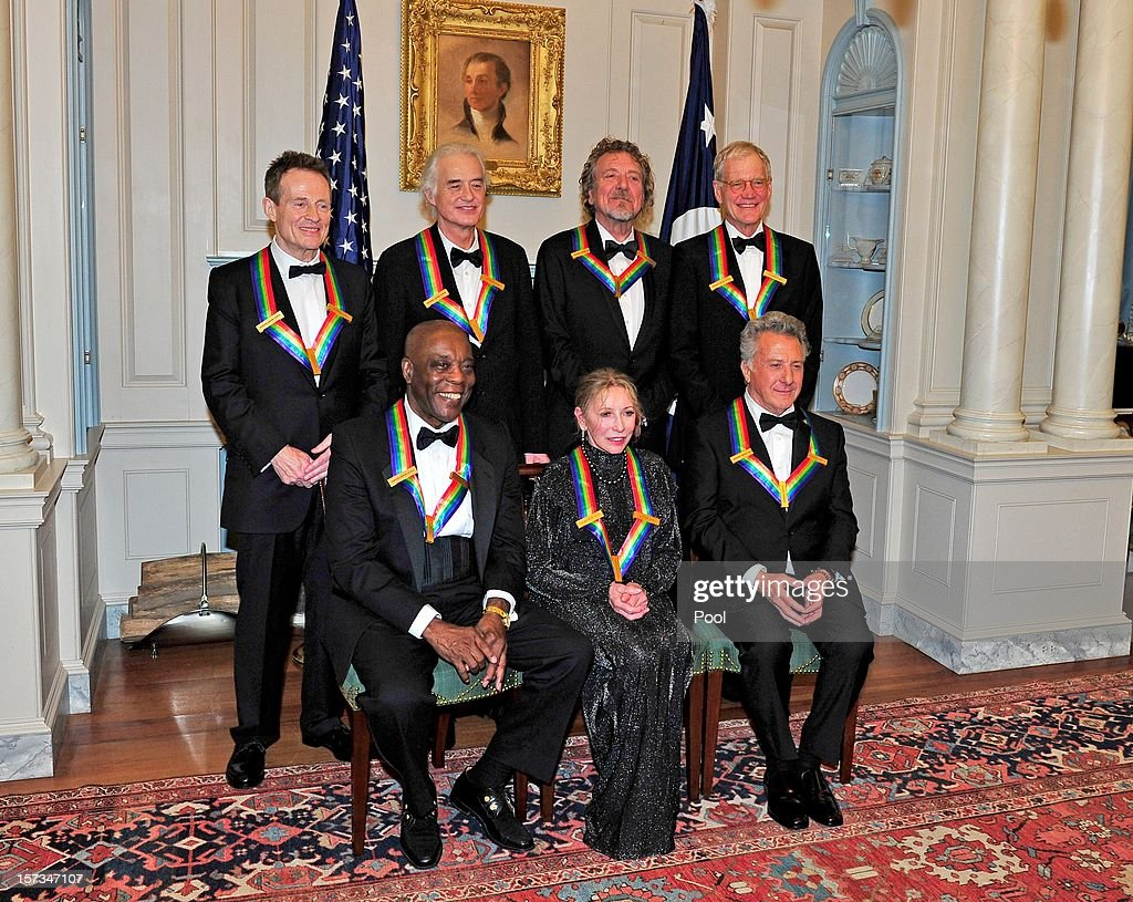 John Paul Jones, Jimmy Page, Robert Plant, David Letterman (L-R Front Row) U.S. Secretary of State Hillary Rodham Clinton, Buddy Guy, Natalia Makarova, Dustin Hoffman pose following a dinner for Kennedy honorees hosted by U.S. Secretary of State Hillary Rodham Clinton at the U.S. Department of State on December 1, 2012 in Washington, DC.