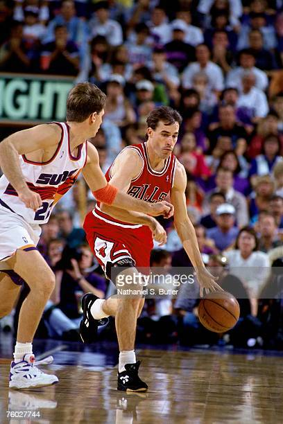 John Paxson of the Chicago Bulls looks to drive to the basket against Danny Ainge of the Phoenix Suns in Game Six of the 1993 NBA Finals on June 20...