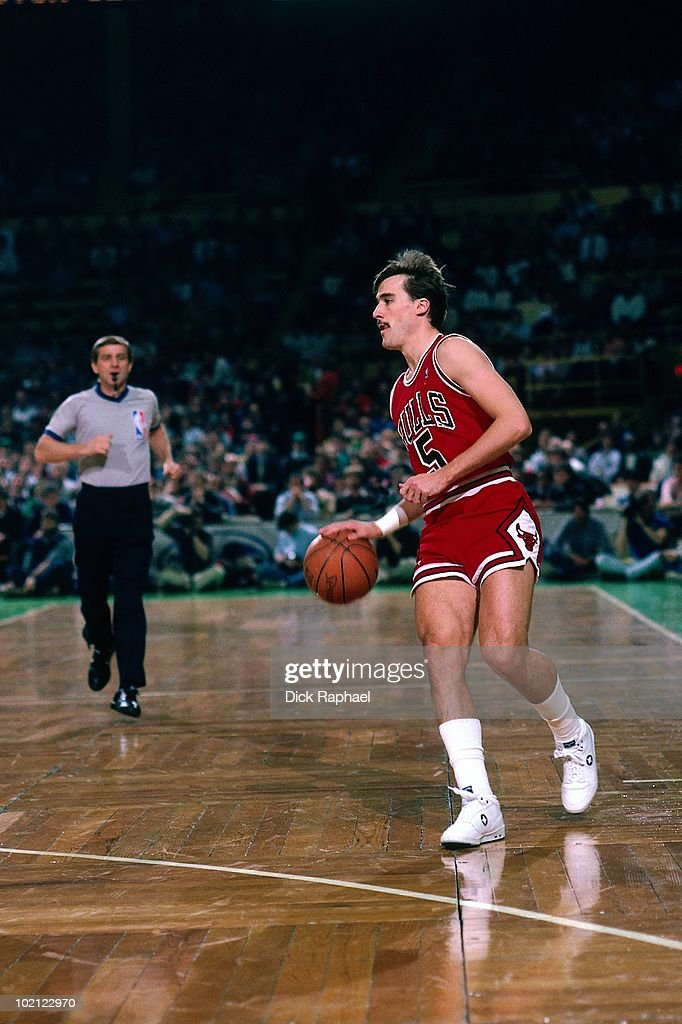 John Paxson #5 of the Chicago Bulls moves the ball up court against the Boston Celtics during a game played in 1987 at the Boston Garden in Boston, Massachusetts.