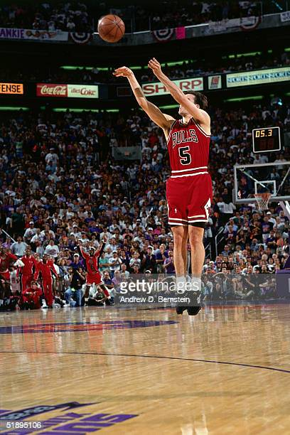 John Paxson of the Chicago Bulls shoots a game winning 3pointer against the Phoenix Suns during Game Six of the 1993 NBA Finals on June 20 1993 in...