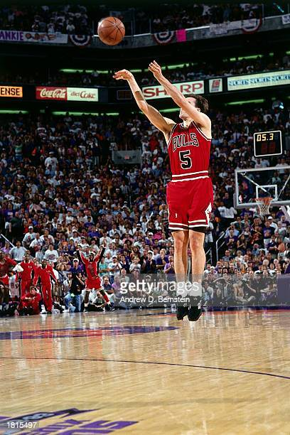 John Paxson of the Chicago Bulls takes a jumper against the Phoenix Suns during Game Six of the 1993 NBA Championship Finals at America West Arena on...