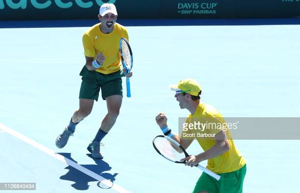 John Peers and Jordan Thompson of Australia celebrate winning the first set in their rubber 3 doubles match against Mirza Basic and Tomislav Brkic of...