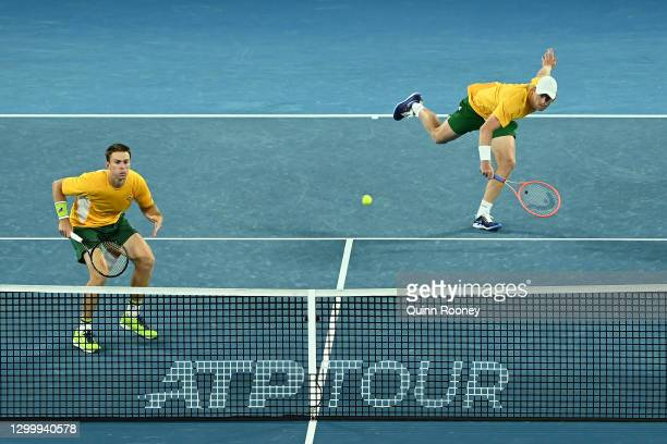 John Peers and Luke Saville of Australia plays in their Group B doubles match against Pablo Carreño Busta and Marcel Granollers of Spain during day...