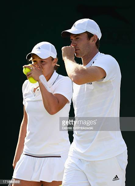 John Peers of Australia and Ashleigh Barty of Australia talk tactics during the Mixed Doubles first round match between Julian Knowle of Austria and...