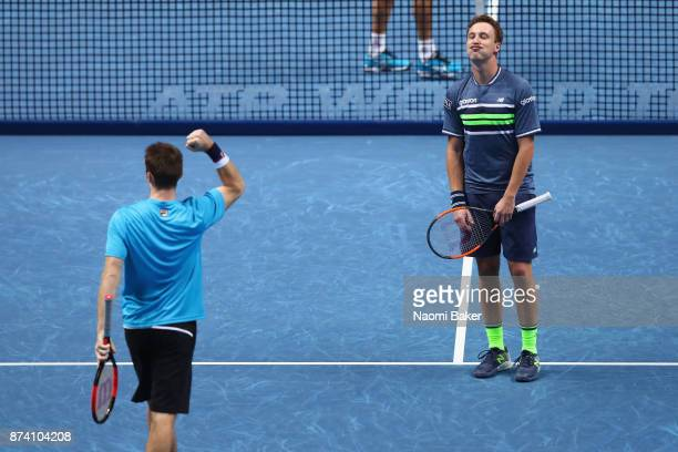 John Peers of Australia and Henri Kontinen of Finland celebrate victory during the doubles match against JeanJulien Rojer of The Netherlands and...