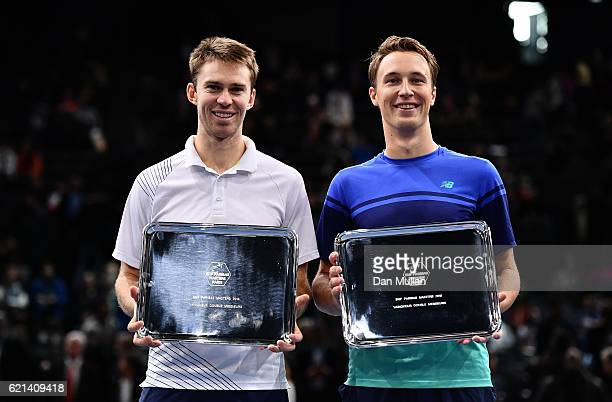 John Peers of Australia and Henri Kontinen of Finland pose with the winners trophies after defeating Pierre-Hughes Herbert and Nicolas Mahut of...