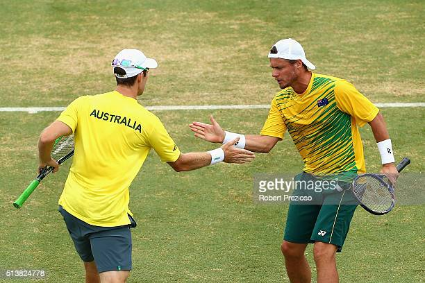 John Peers of Australia and Lleyton Hewitt of Australia in action in Men's doubles match against Mike Bryan and Bob Bryan of the United States during...