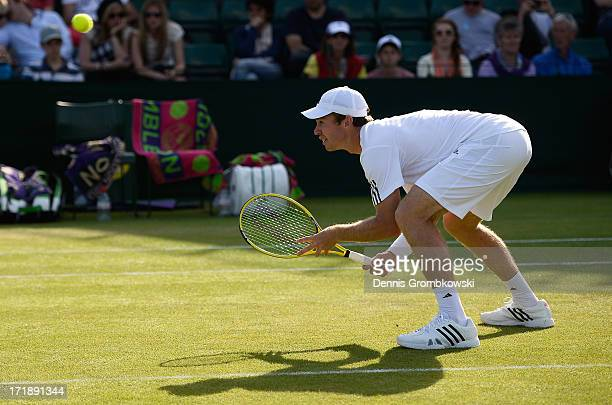 John Peers of Australia in action during the Mixed Doubles first round match between Julian Knowle of Austria and Shuai Zhang of China and John Peers...