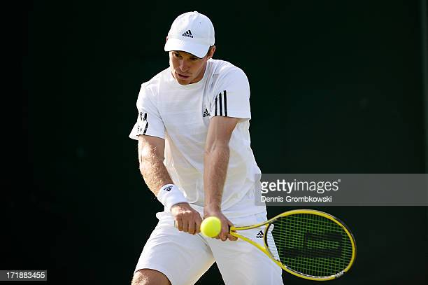 John Peers of Australia plays a backhand during the Mixed Doubles first round match between Julian Knowle of Austria and Shuai Zhang of China and...